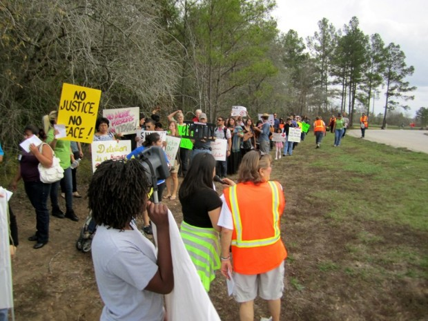 Activists marching outside the Polk detention center